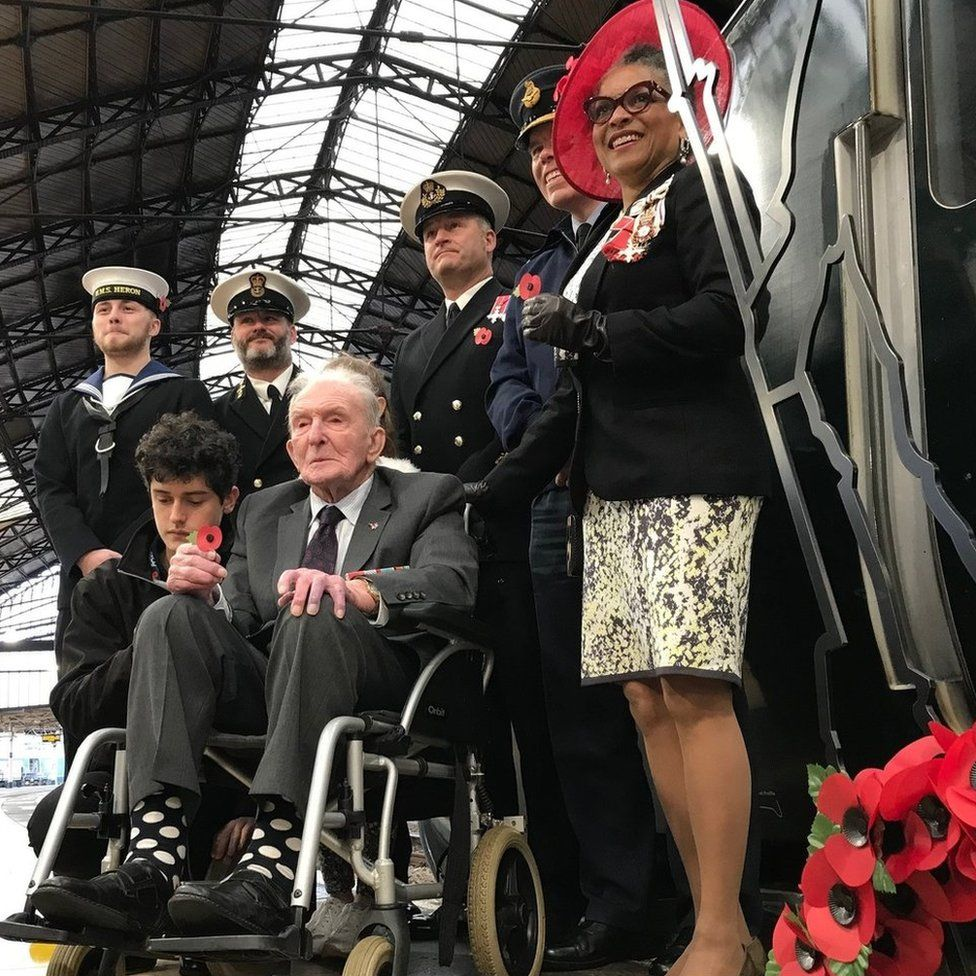 "Dambuster veteran George ""Johnny"" Johnson and other service personnel at Bristol's Temple Meads station"
