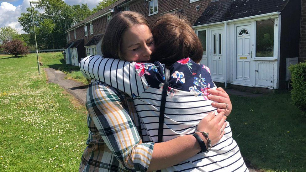 Hospital ward manager Viv Hudson, 58, wept with joy as she finally hugged her NHS worker daughter Theresa Fox this afternoon