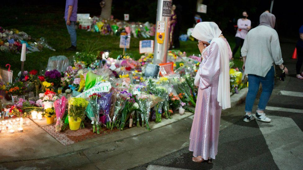 Members of the Muslim community and supporters light candles and place flowers at a memorial on June 8, 2021 in London, Canada