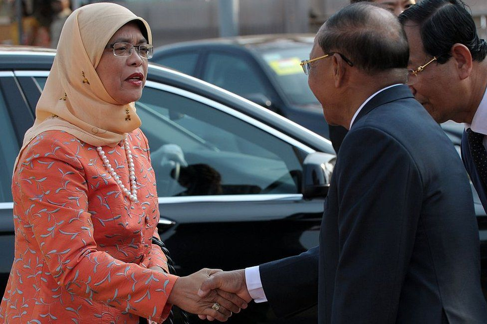 Singaporean Member of Parliament (MP) and National Trades Union Congress Assistant Secretary-General, Halimah Yacob (L) shakes hands with Cambodian President of National Assembly Heng Samrin (R) upon her arrival at the National Assembly building in Phnom Penh on 7 May 2015.