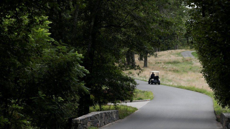 A Secret Service agent patrols the golf course