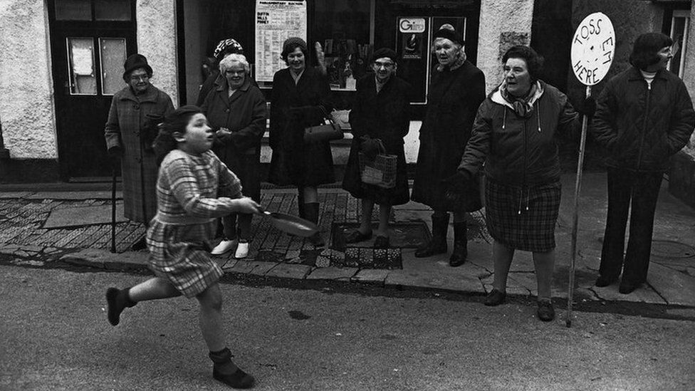 Diane Hiscock competing in the pancake race, Fore Street, Dolton, 1974