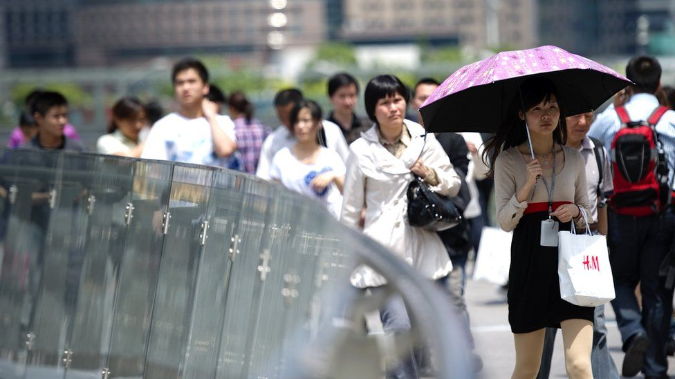 White-collars workers walk to their lunch break in Pudong Luziajui business district in Shanghai, China,
