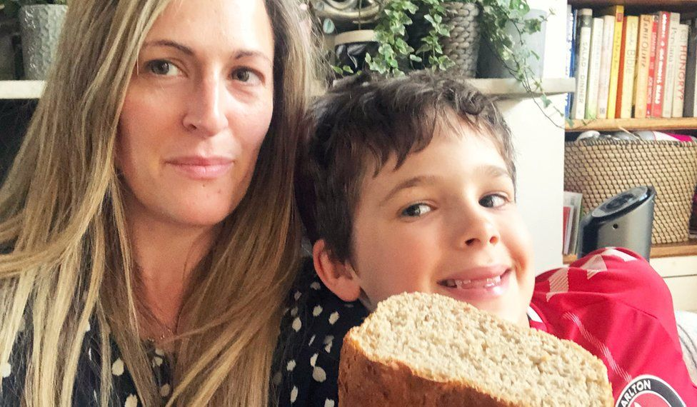 Zoe and her son with their homemade bread