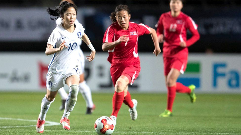 Women's football match between South and North Korea