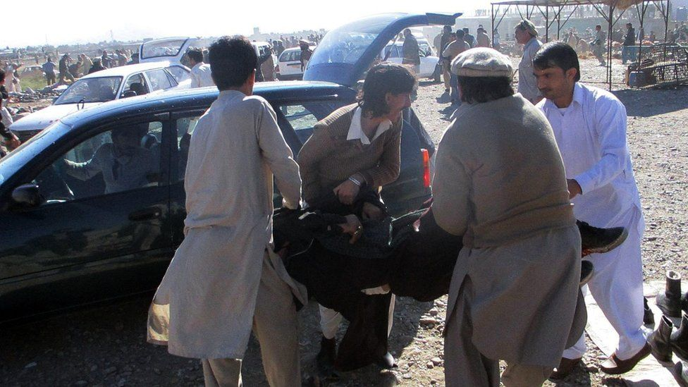 Pakistani men evacuated the injured in Parachinar