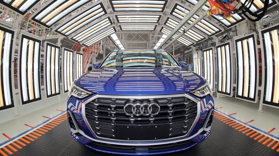 Employees work on the assembly line of Audi Q3