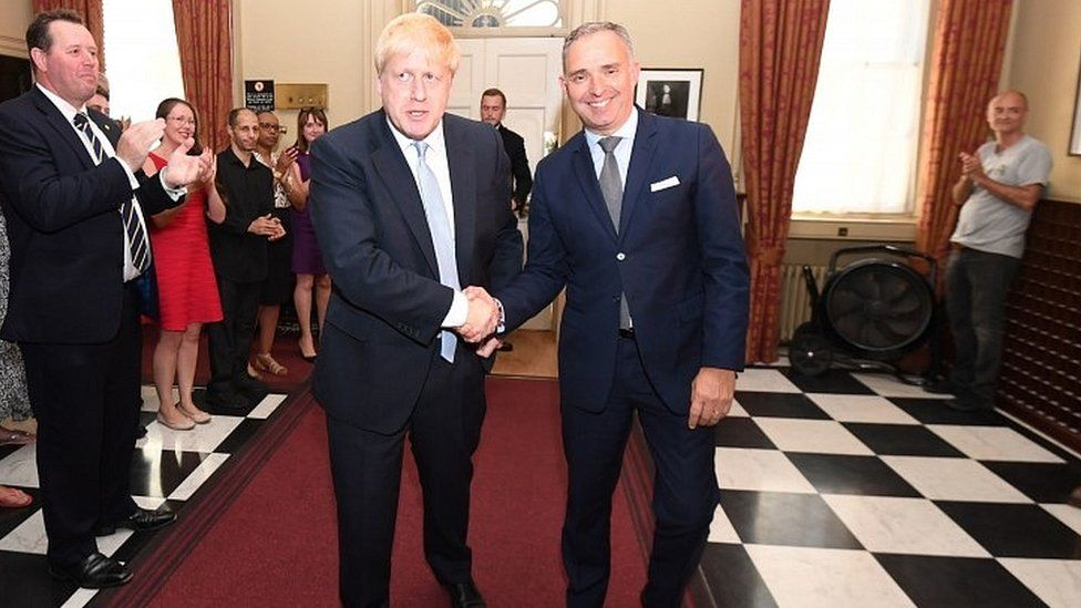 Sir Mark Sedwill welcomes Boris Johnson to Downing Street after he became prime minister in July 2019