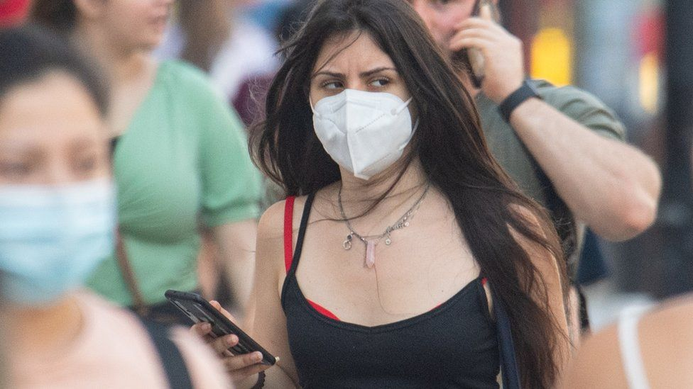 People wearing face mask in central London, after the final coronavirus legal restrictions were lifted in England.