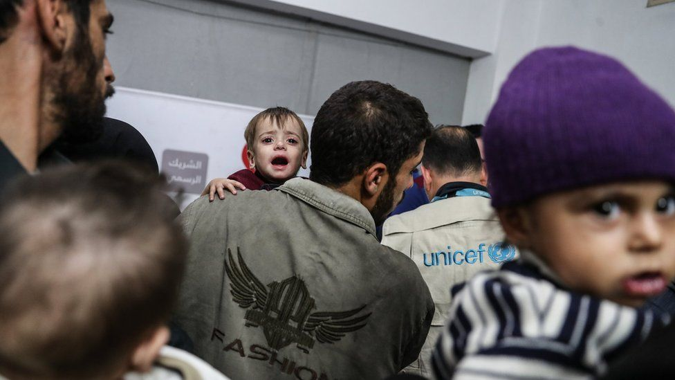 Children suffering from malnutrition wait to be seen by UN doctors in Douma, in the Eastern Ghouta, Syria (12 November 2017)
