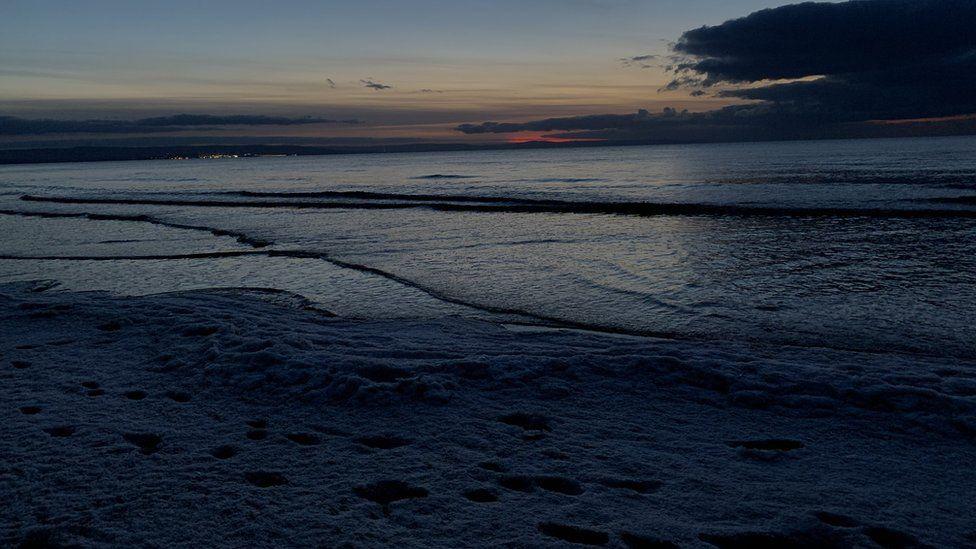 Frozen sea foam at Berrow Beach in North Somerset