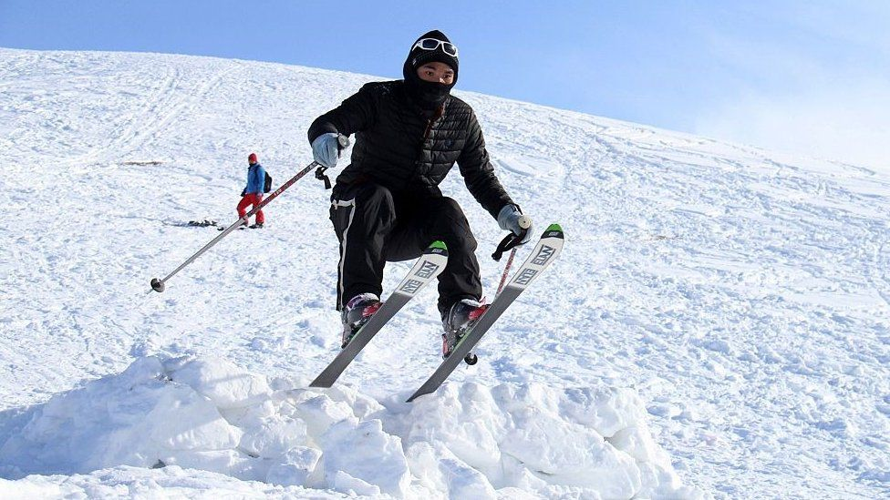 An Afghan competitor takes part in the sixth annual ski challenge event in Bamiyan province on February 5, 2016