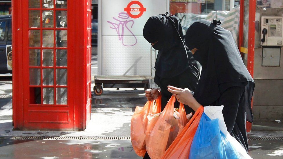 File photo dated 2013, showing two Muslim women shopping in London in full-face veils.