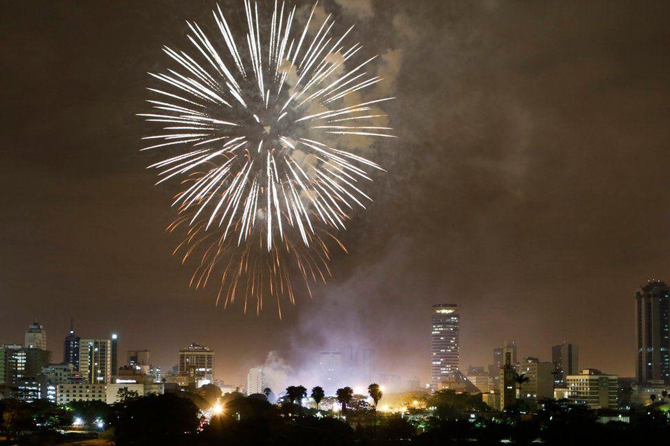 "Fireworks illuminate the night sky over the Kenyatta International Convention Centre (KICC) during New Year""s Eve celebrations in Nairobi, Kenya"