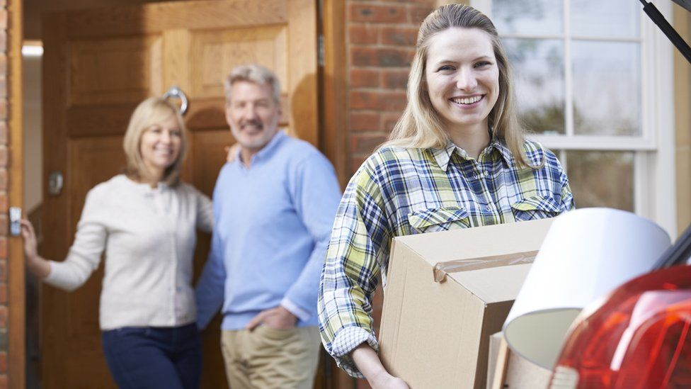 Young woman moving out of her parents' home