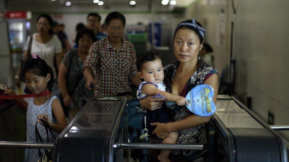 A mother arrives at a subway station to an event of the world breastfeeding week