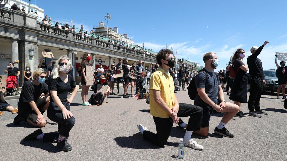 Protesters from Black Lives Matter take part in a silent vigil on Brighton Pier