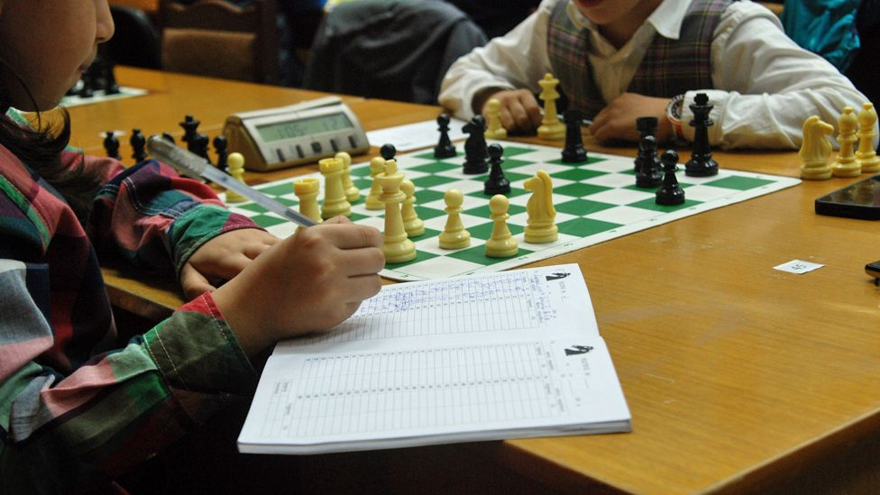 children practice chess
