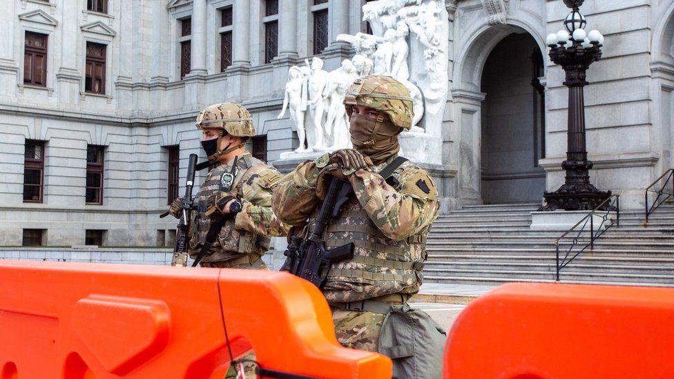 Armed Pennsylvania National Guard members protect the Pennsylvania State Capitol.