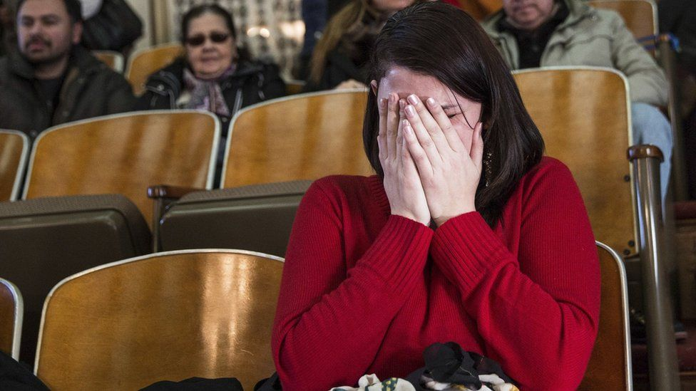 Anne Devlin, from Plano, Texas, cries in the gallery of the House of Representatives after the Electoral College voted at the state Capitol in Austin, Texas