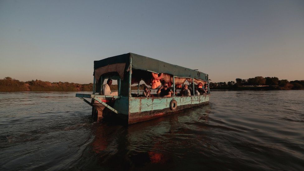 Tourists sail across the convergence between the White Nile river and Blue Nile river in Khartoum, Sudan, 15 February 2020