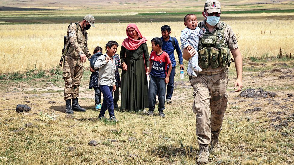 Turkish security forces patrolling the border with Iran help an exhausted Afghan family - 6 August 2021