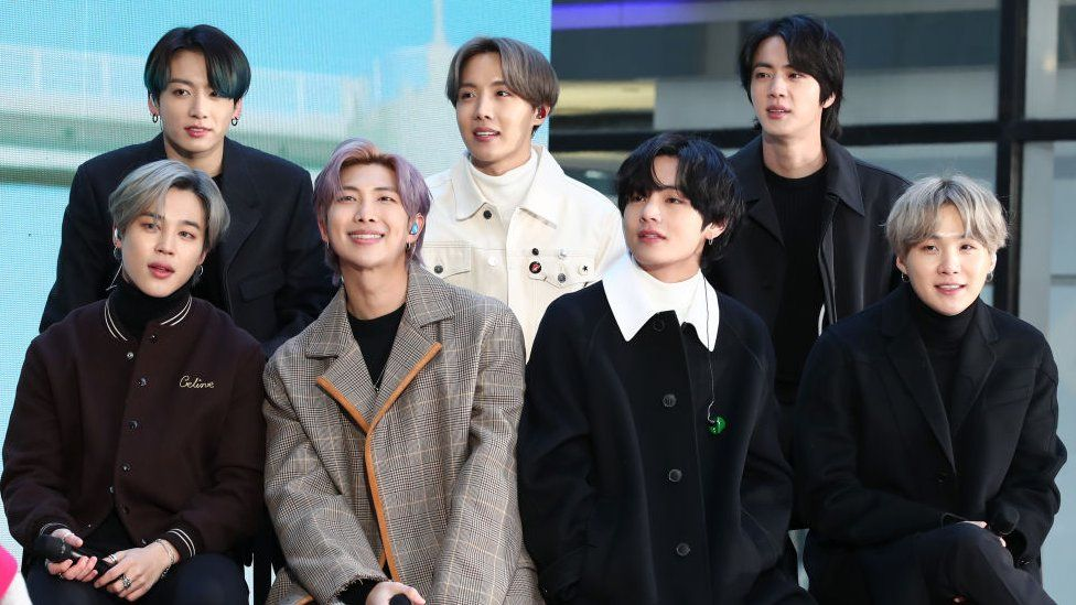 BTS: Radio host apologises for comparing band to Covid - BBC News