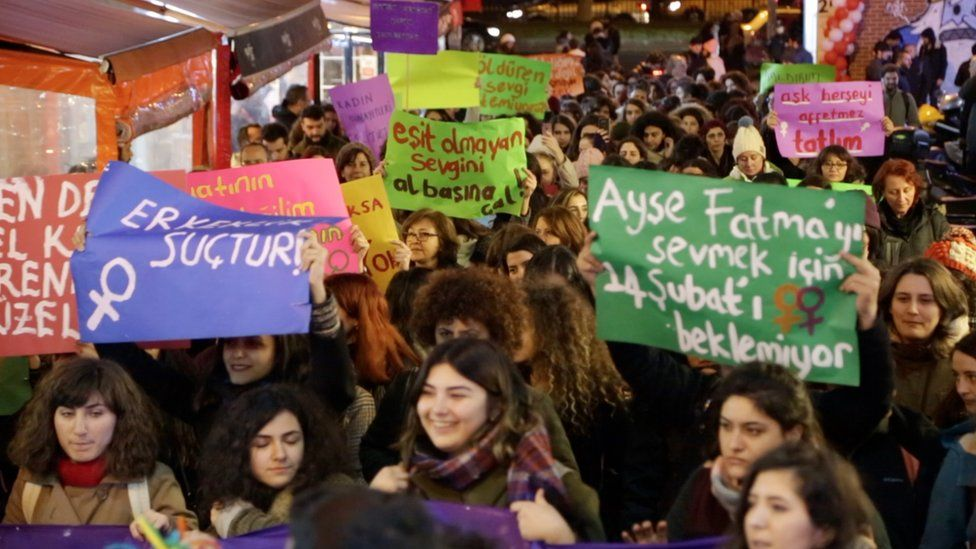 Women hold banners in favour of gender equality during a protest in Istanbul