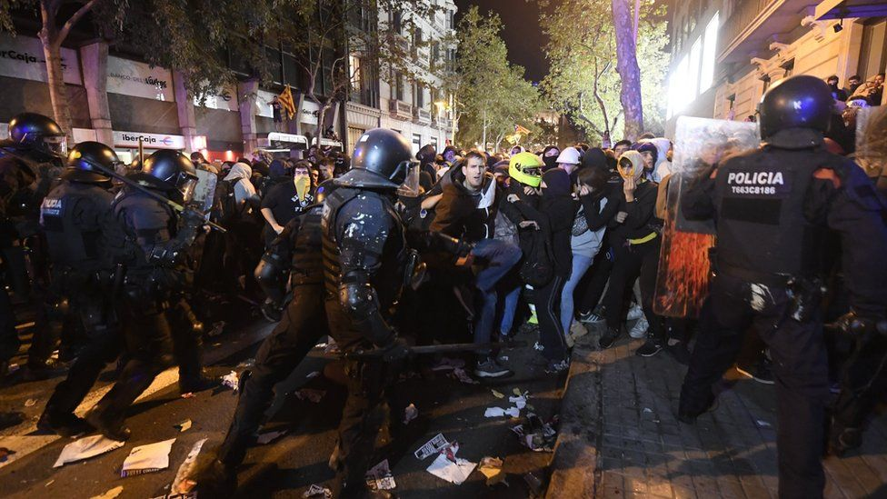 Riot police hold back protesters in Barcelona, Spain on 15 October