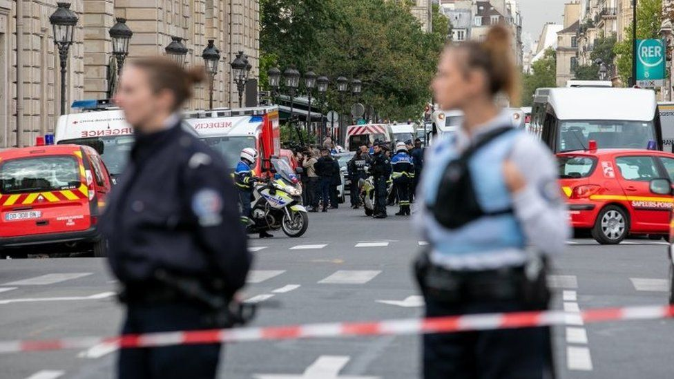 Police personnel block the bridge near Paris Police headquarters on 3 October 2019 in Paris, France