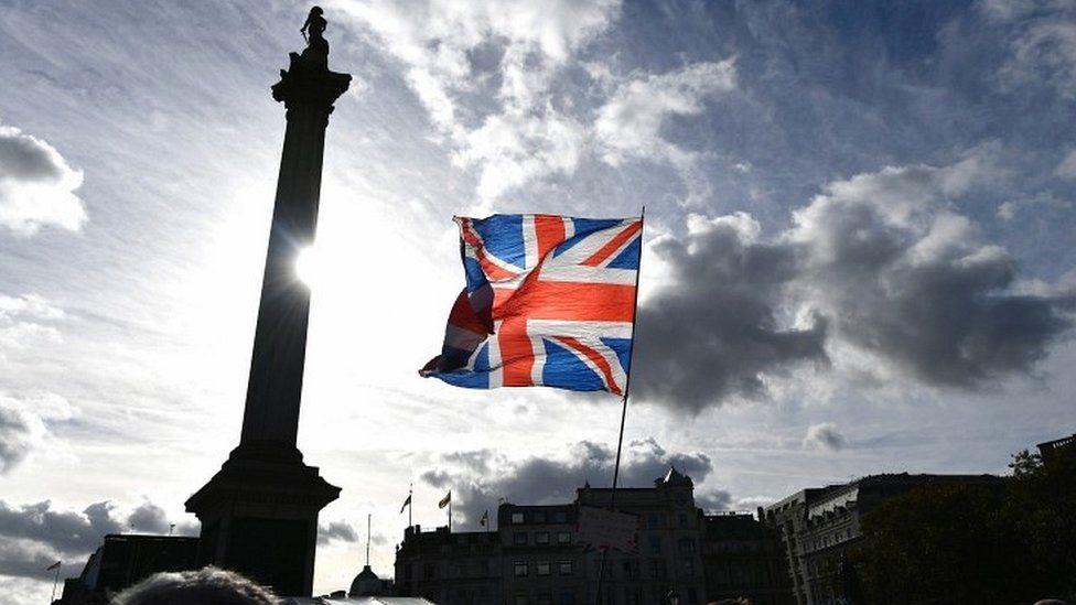 Union Jack held up in Trafalgar Square