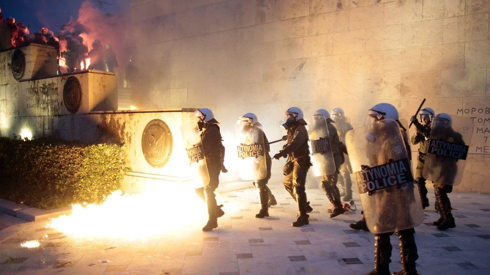 Greek police clash with protesters in front of parliament on May 18, 2017 in Athens