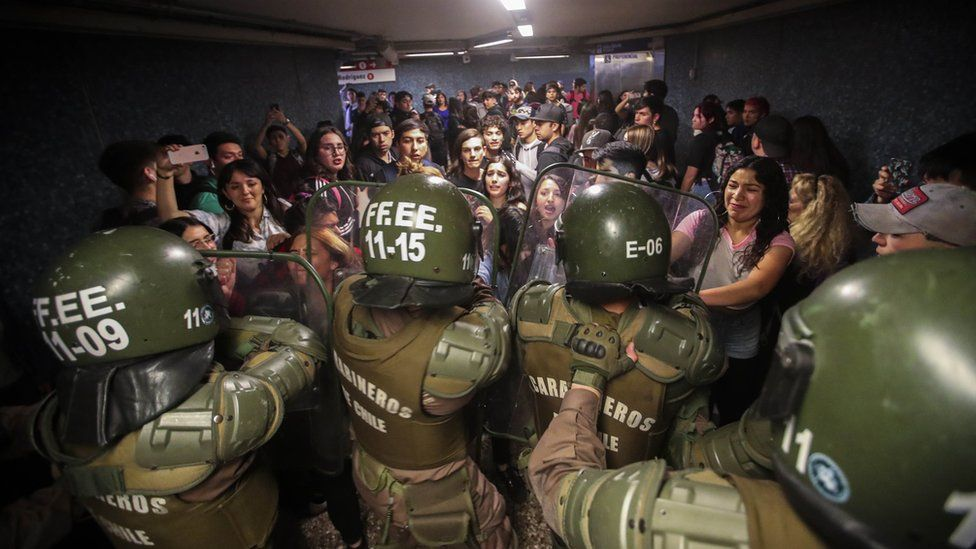 Chilean Police close the access to the Los Heroes metro station in the middle of a demonstration, in Santiago
