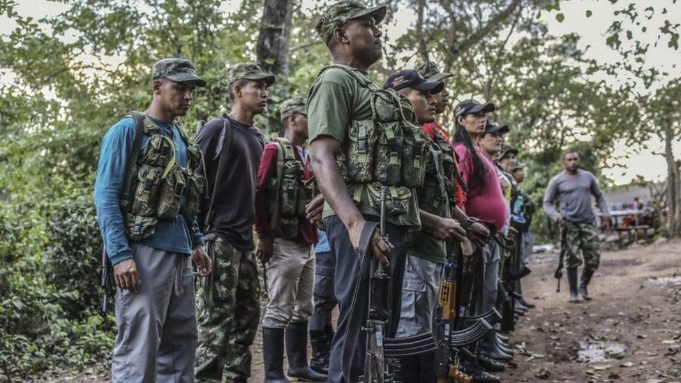 Farc guerrillas fall in during a review at their camp in the Transitional Standardization Zone in Pondores, La Guajira department, Colombia (05 April 2017)