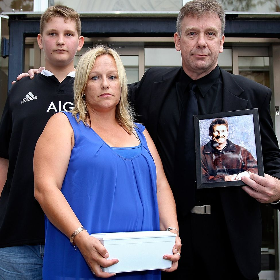 Lee-Anne Cartier carrying her brother Phil's ashes, with another brother, Andrew and a nephew