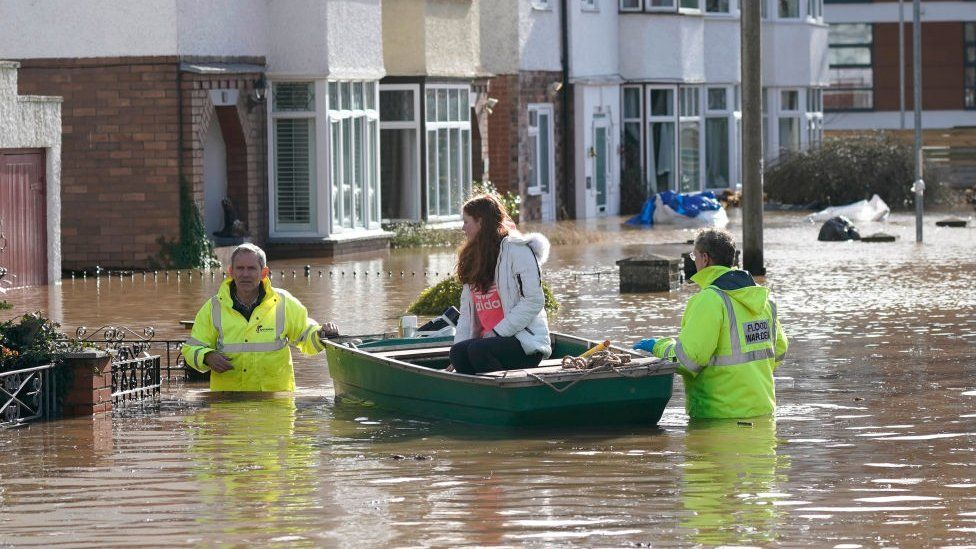 Rescue workers help a resident to safety on a boat following Storm Dennis on February 17, 2020 in Hereford