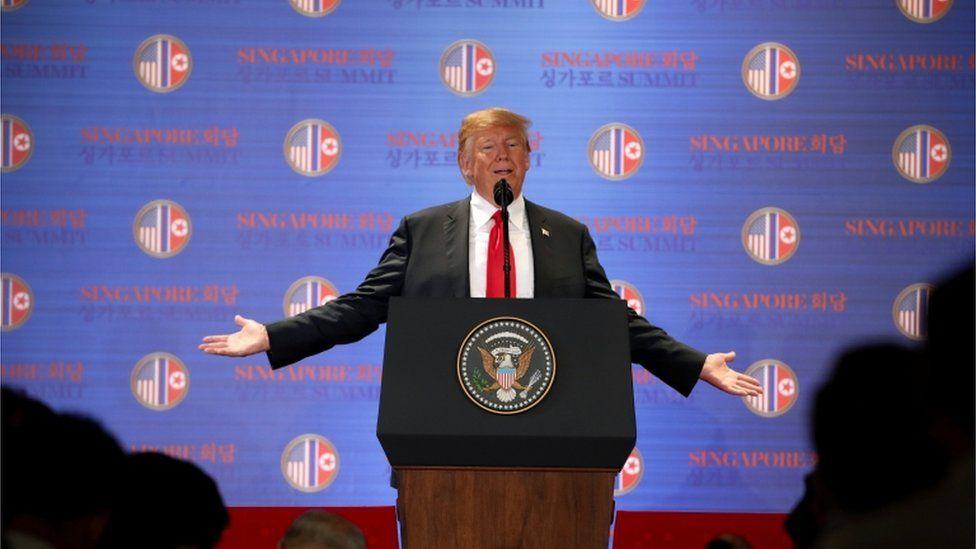 Photo of Donald Trump at a podium in Singapore
