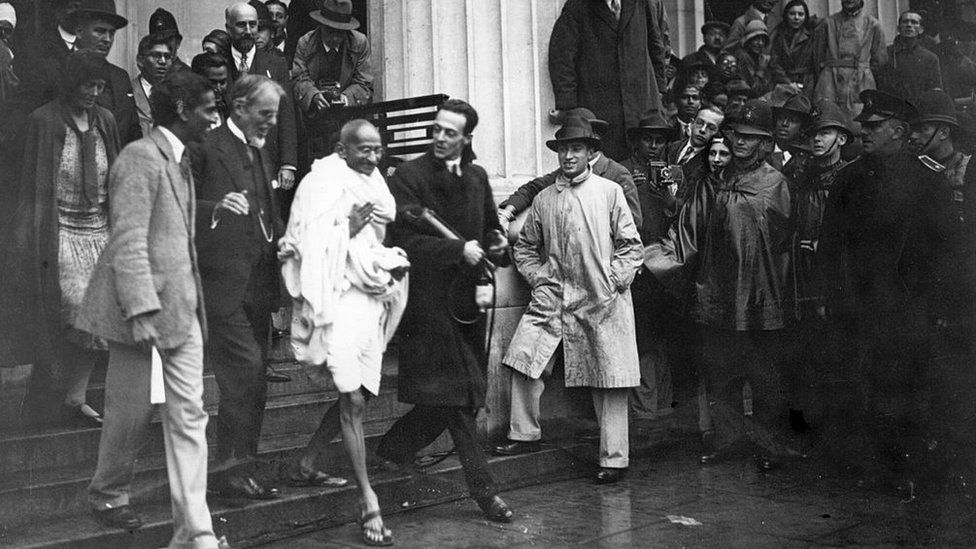 Mahatma Gandhi leaves the Friends' Meeting House, Euston Road, after attending the Round Table Conference on Indian constitutional reform.
