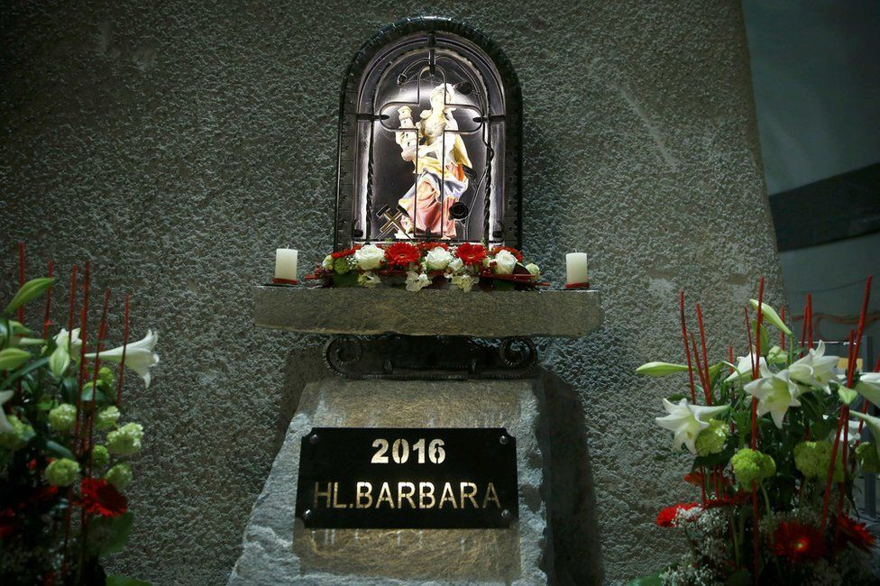 A statue of St Barbara, patron saint of miners, stands inside the Gotthard tunnel, 1 June