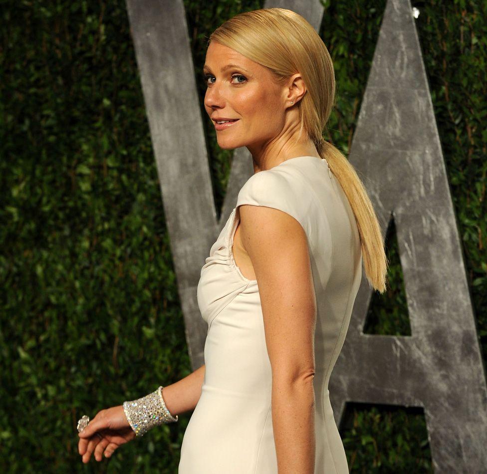 Gwyneth Paltrow arrives at the 2012 Vanity Fair Oscar Party wearing a diamond bracelet designed by Anna Hu