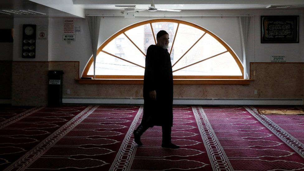 An imam arrives to make the call to pray in New York