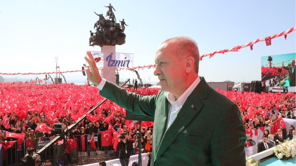 A handout photo made available by the Turkish President Press office shows Turkish President Recep Tayyip Erdogan as he greets supporters during his Justice and Development Party (AK Party) and Nationalist Movement Party (MHP) local election campaign rally in Izmir, Turkey, 17 March 2019