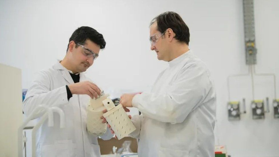 Design Engineer Saqib Ali, left, and Dr Sterghios Moschos look at a prototype of the breath collecting device