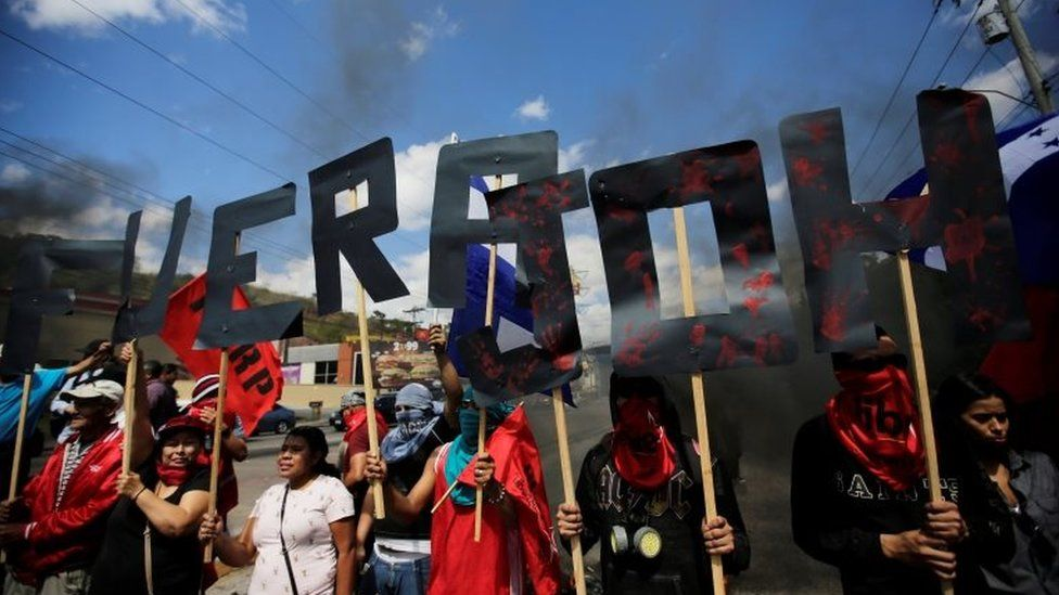 """Demonstrators form the words """"JOH Out"""" during a protest against Honduras"""" President Juan Orlando Hernandez and his government in Tegucigalpa, Honduras, January 27, 2019."""