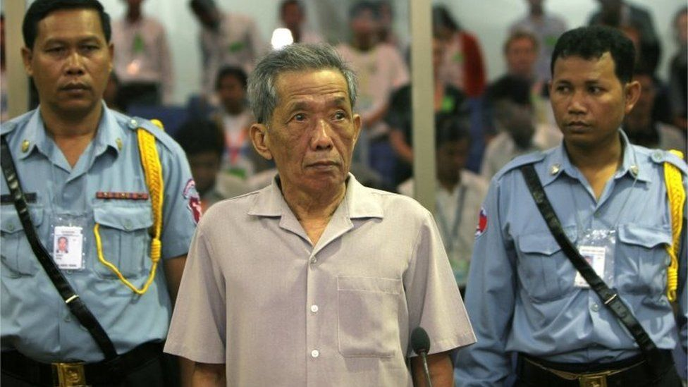 FILE PHOTO: Former Khmer Rouge S-21 prison chief Kaing Guek Eav, better known as Duch, stands in a courtroom during a pre-trial in Phnom Penh, Dec. 5, 2008.