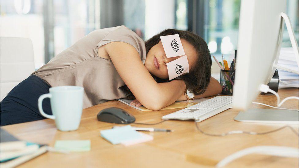 Woman asleep at desk