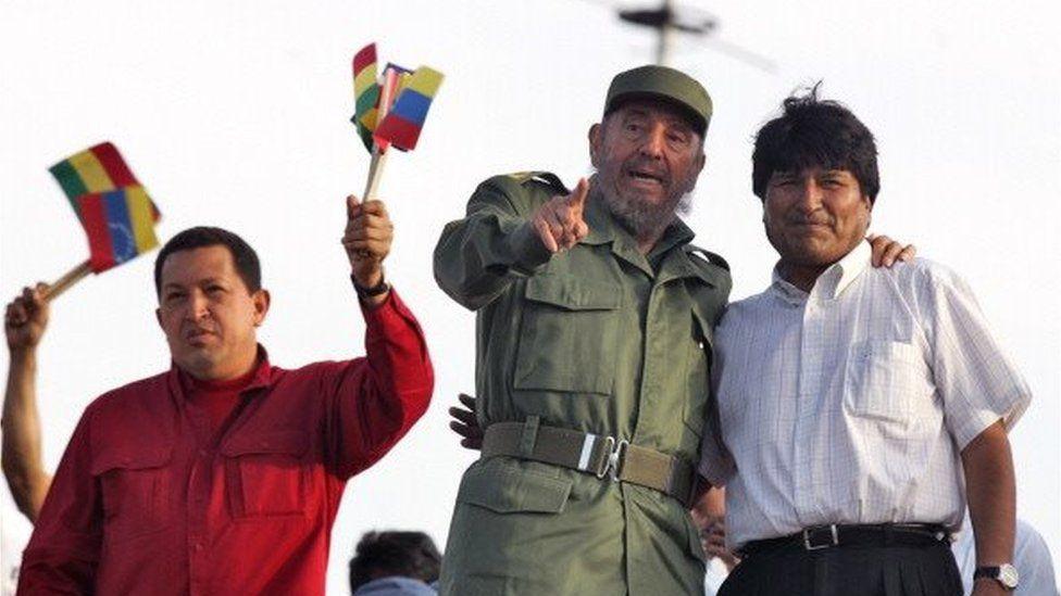 The Presidents of Venezuela, Cuba and Bolivia, Hugo Chavez (L) Fidel Castro and Evo Morales wave to supporters during a rally at the Plaza de la Revolucion in Havana, 29 April, 2006.