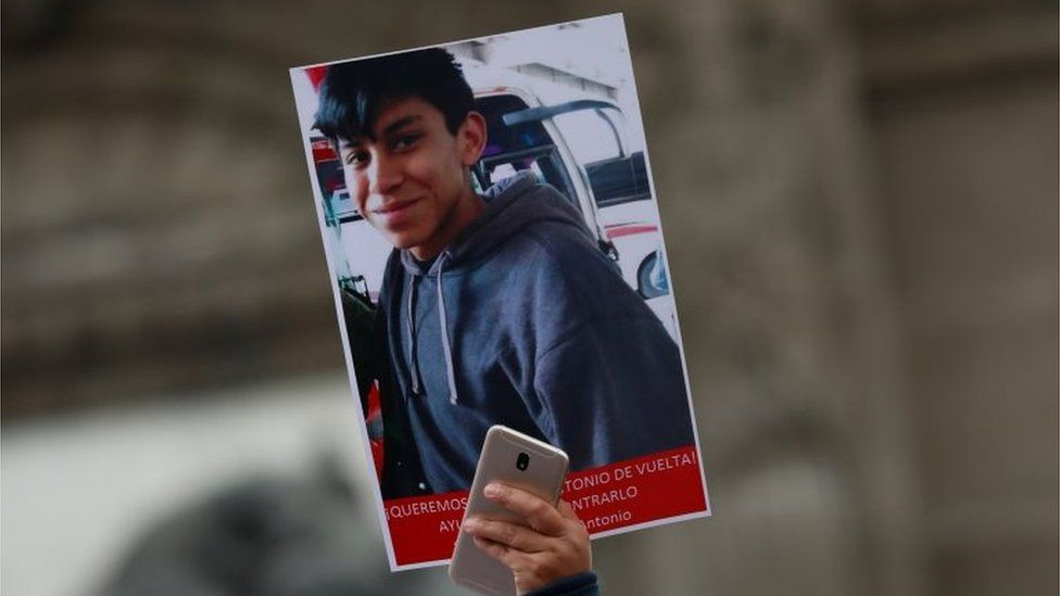 A demonstrator holds up a poster with a picture of high school student Marco Antonio Sanchez, who disappeared several days ago after a dispute with police officers, according to local media, in a protest march demanding to know his whereabouts at the Angel of Independence in Mexico City, Mexico January 28, 2018.