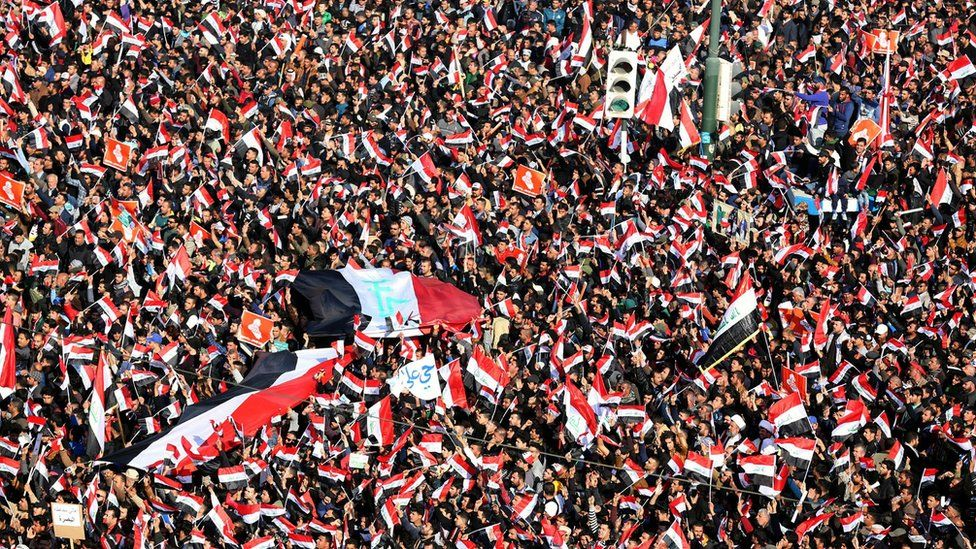 Supporters of Iraqi Shia cleric Moqtada al-Sadr wave national flags and chant slogans during a demonstration at al-Tahrer square, central Baghdad, Iraq, 11 February 2017