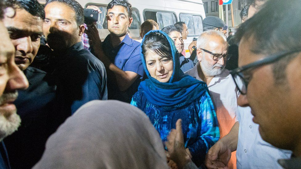 Mehbooba Mufti Chief Minister of Jammu and Kashmir consoles the mother of Syed Shujaat Bukhari, the editor of Rising Kashmir daily newspaper
